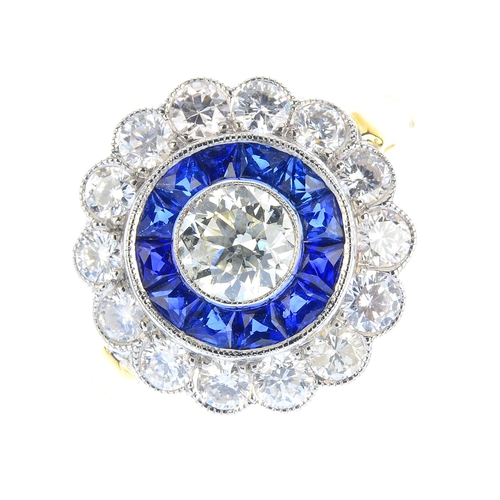 114 - A diamond and sapphire dress ring. The brilliant-cut diamond, with calibre-cut sapphire and brillian...