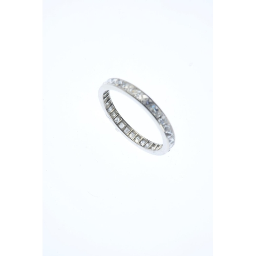 118 - A diamond full eternity ring. Designed as a French-cut diamond line. Estimated total diamond weight ...