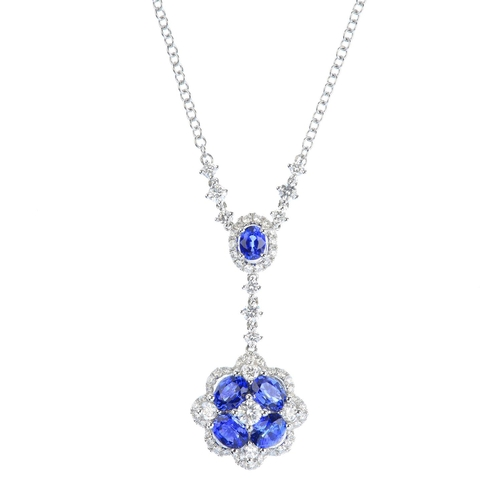 119 - A sapphire and diamond necklace. Comprising a brilliant-cut diamond and oval-shape sapphire floral c...