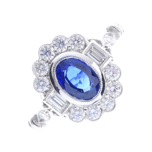 120 - An 18ct gold sapphire and diamond cluster ring. The oval-shape sapphire, with brilliant and baguette...