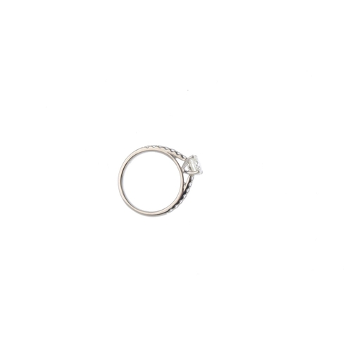 122 - A platinum diamond single-stone ring. The brilliant-cut diamond, weighing 1ct, with similarly-cut di...