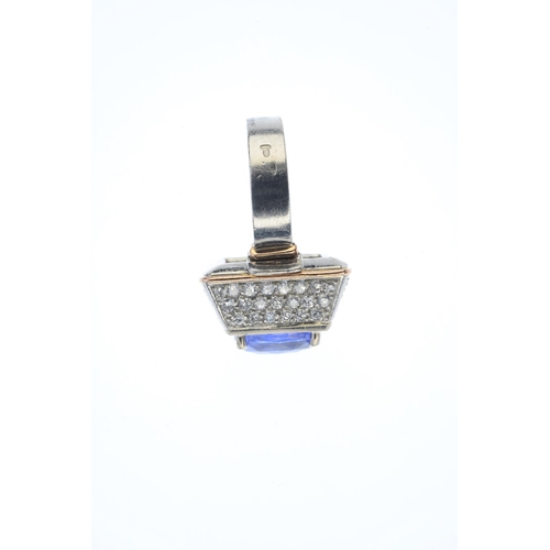 125 - A Sri Lankan sapphire and diamond dress ring. The oval-shape sapphire, set atop a pave-set diamond, ...