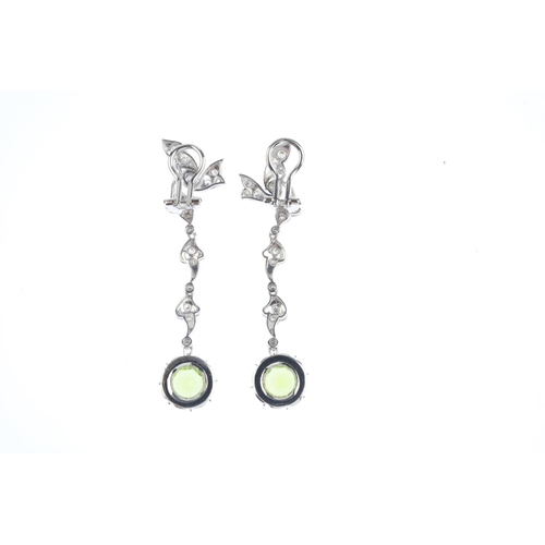 126 - A pair of peridot and diamond earrings. Each designed as a circular-shape peridot, suspended from a ...