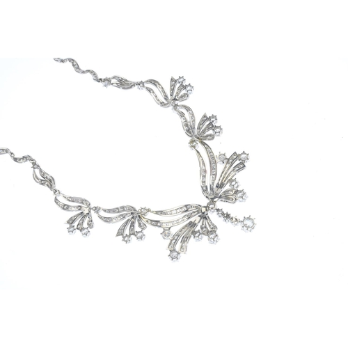 128 - A mid 20th century diamond necklace. The old and brilliant-cut diamond articulated line, with gradua...