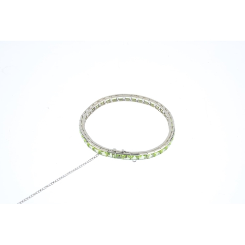 130 - A peridot bracelet. Designed as a rectangular-shape peridot line, with partially concealed push-piec...