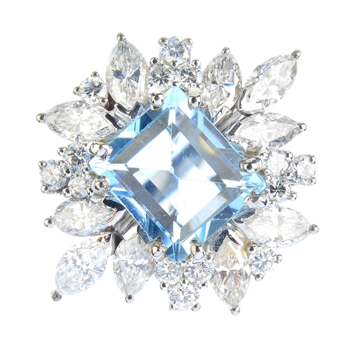 134 - An aquamarine and diamond cluster ring. The rectangular-shape aquamarine, with marquise and brillian...
