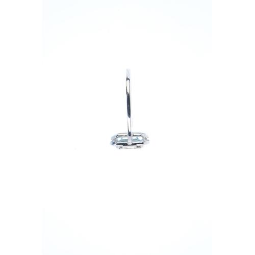 136 - An aquamarine and diamond dress ring. The rectangular-shape aquamarine, with brilliant and baguette-...
