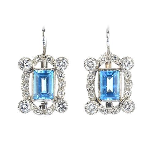 137 - A pair of aquamarine and diamond earrings. Each designed as a rectangular-shape aquamarine, with bri...