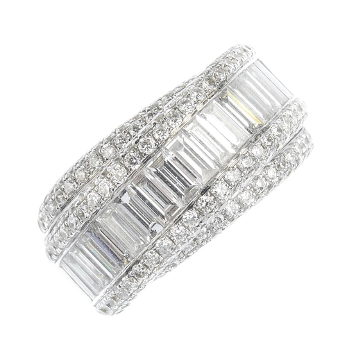138 - An 18ct gold diamond dress ring. The baguette-cut diamond line with pave-set diamond border, raised ...