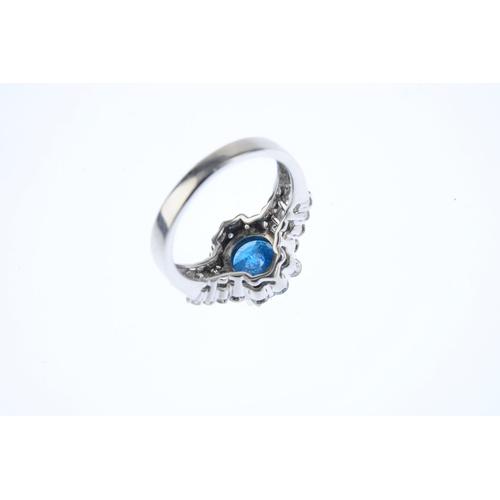 140 - A Fancy Deep Greenish Blue diamond and diamond cluster ring. The brilliant-cut Fancy Deep Greenish B...