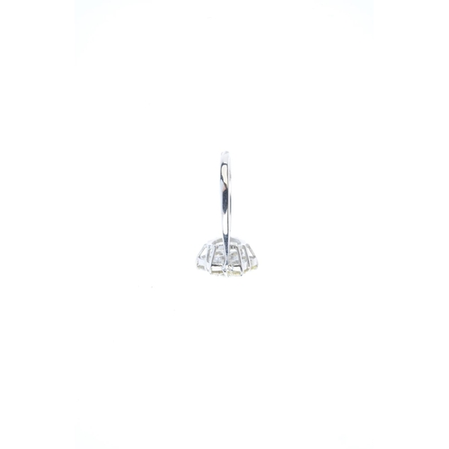 141 - A diamond floral cluster ring. Designed as a brilliant-cut diamond, with similarly-cut diamond surro...