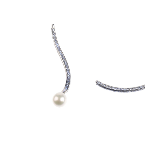 143 - An 18ct gold sapphire and cultured pearl collar. Of torque design, the pave-set sapphire scrolling t...