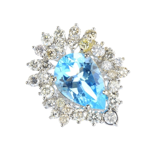 146 - A topaz and diamond dress ring. The pear-shape blue topaz, with vari-cut diamond stylised foliate su...