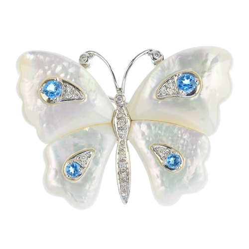 147 - A mother-of-pearl, diamond and topaz butterfly brooch. The pave-set diamond body, to the mother-of-p...