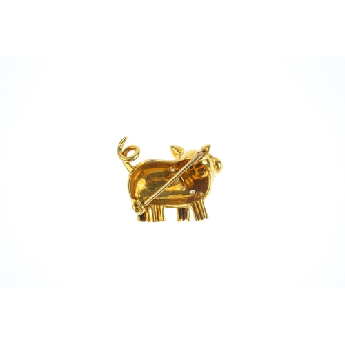 149 - An 18ct gold sapphire and diamond brooch. Designed as a pig, with circular sapphire cabochon eyes an...