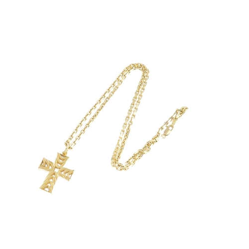 152 - CASSANDRA GOAD - an 18ct gold cross pendant. Of openwork design, the chevron motif cross, suspended ...