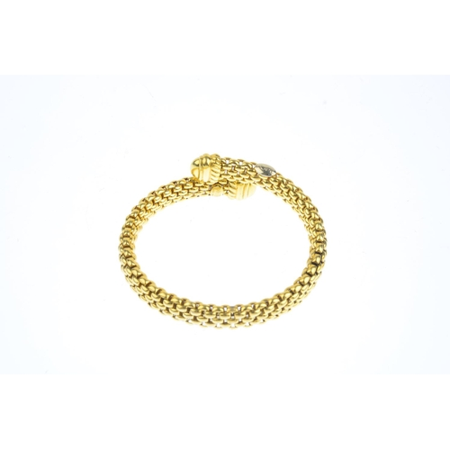 153 - FOPE - a bangle. The mesh-link crossover cuff, with curved bar terminals. Signed Fope. Italian marks...