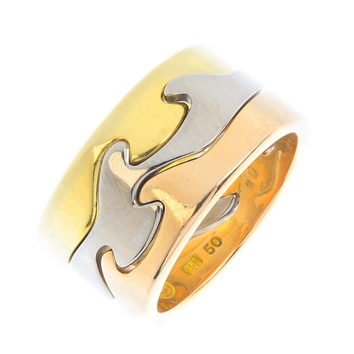 156 - GEORG JENSEN - a 'Fusion' ring. Of tri-colour design, comprising three, interlocking bands. Maker's ...