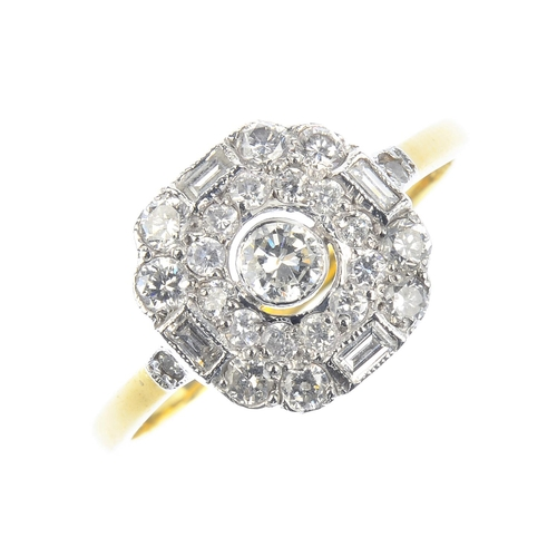 165 - A diamond cluster ring. The brilliant-cut diamond collet, with brilliant and baguette-cut diamond ge...