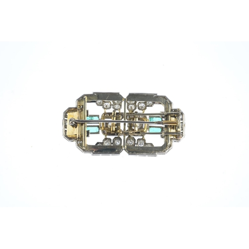 168 - A mid 20th century emerald and diamond double clip brooch. Of openwork design, comprising two circul...