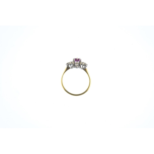 17 - A ruby and diamond ring. The oval-shape ruby, with brilliant-cut diamond wreath sides. Estimated tot...