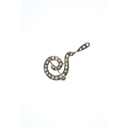 173 - A late Victorian silver and gold, diamond question mark brooch. The scrolling, graduated old-cut dia...