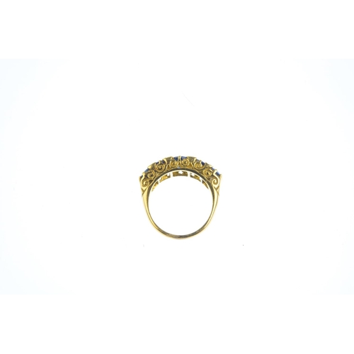 174 - An 18ct gold sapphire five-stone and diamond ring. The graduated oval and circular-shape sapphire li...