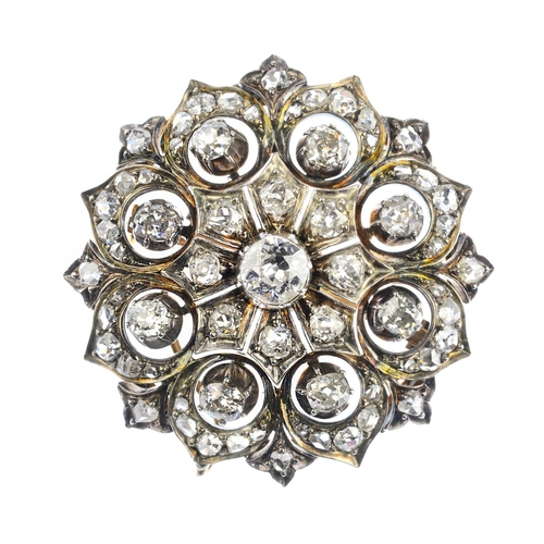 175 - A late Victorian diamond floral brooch. Of openwork design, the old-cut diamond, with vari-cut diamo...