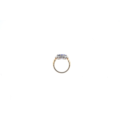 176 - An early 20th century 18ct gold sapphire and diamond cluster ring. The cushion-shape sapphire, with ...