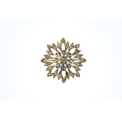 177 - A sapphire and diamond floral brooch. Of openwork design, the brilliant-cut diamond and circular-sha...