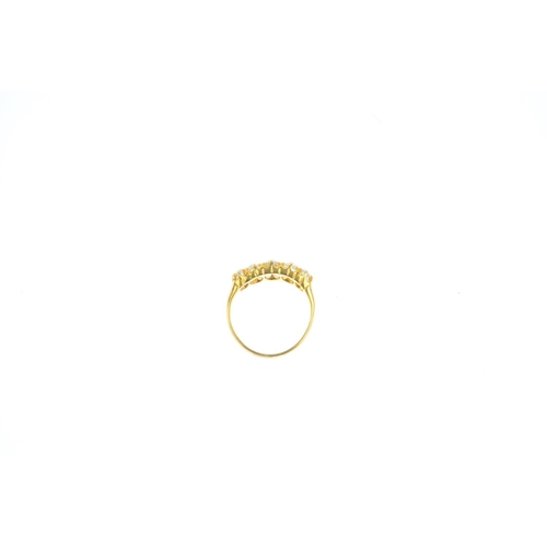 179 - A late Victorian 18ct gold diamond five-stone ring. The graduated old-cut diamond line, with openwor...