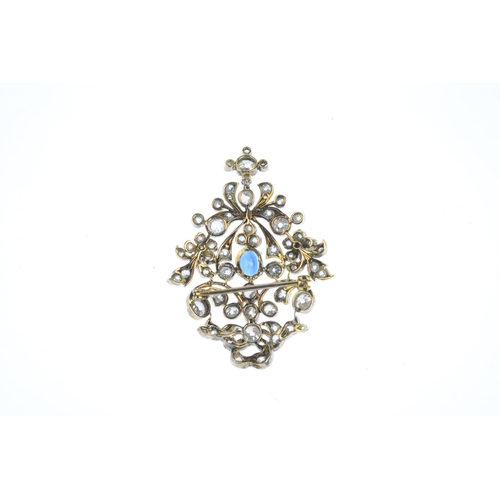 180 - A late Victorian sapphire and diamond brooch. Of openwork design, the oval-shape sapphire, with old-...