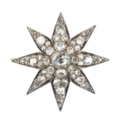 181 - A late Victorian diamond star brooch. The old-cut diamond, with vari-cut diamond ray surround. Estim...