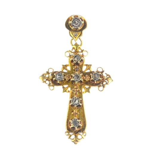 182 - A diamond cross pendant. The illusion-set rose-cut diamonds, with floral spacers and scrolling surro...