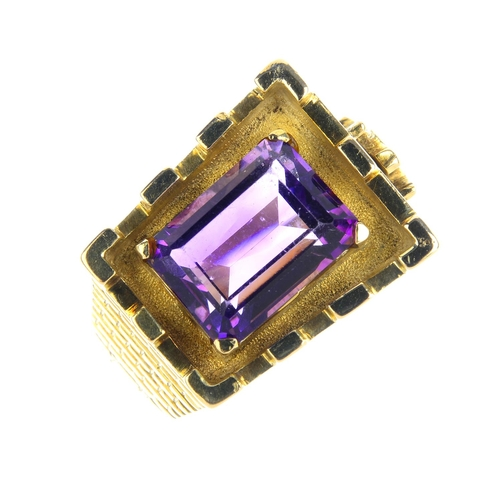 187 - An amethyst dress ring. Designed as a stylised castle turret, with figure scaling the wall, enclosin...