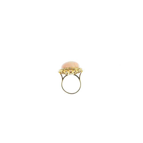 189 - A coral and diamond cluster ring. The coral cabochon, with single-cut diamond surround. Diameter of ...