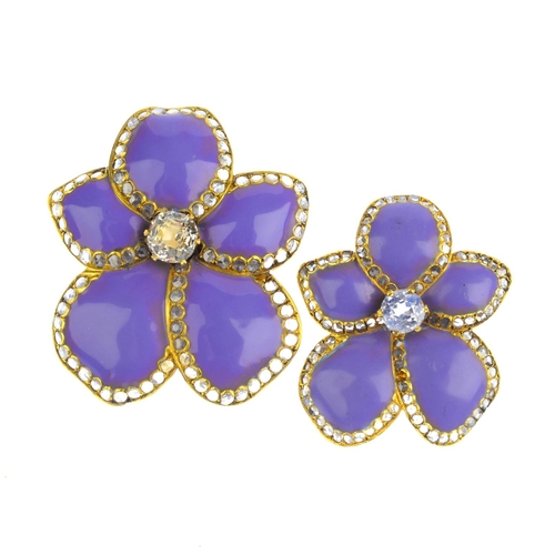 192 - Two diamond, sapphire and enamel floral brooches. Each designed as a white sapphire, with purple ena...
