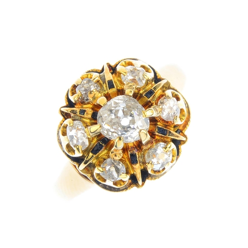 197 - A Victorian gold diamond and enamel cluster ring. Of openwork design, the old-cut diamond, with simi...