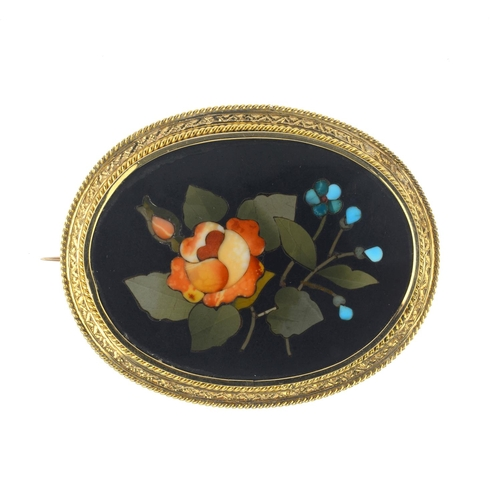 199 - A late Victorian gold pietra dura brooch. Of oval outline, the hardstones depicting a rose and forge...