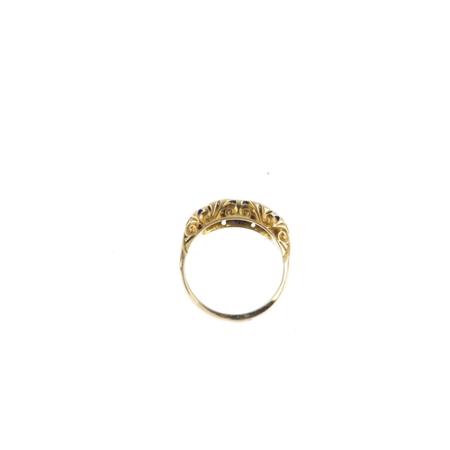 2 - An Edwardian 18ct gold sapphire three-stone and diamond ring. Designed as a graduated cushion-shape ...