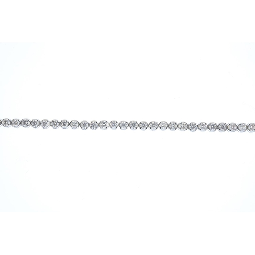 20 - An 18ct gold diamond bracelet. The brilliant-cut diamond line, with partially-concealed clasp. Estim...