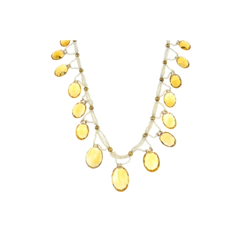 202 - A seed pearl and citrine necklace. The graduated oval-shape citrine fringe, suspended from seed pear...