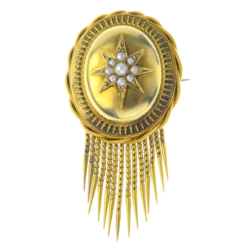 207 - A late Victorian gold split pearl brooch. The split pearl star, set atop an oval dome with cannetill...