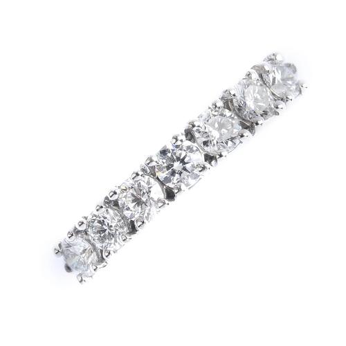 210 - An 18ct gold diamond half eternity ring. Designed as a brilliant-cut diamond line, with tapered shou...