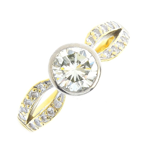 22 - An 18ct gold diamond single-stone ring. The brilliant-cut diamond collet, with similarly-cut diamond...