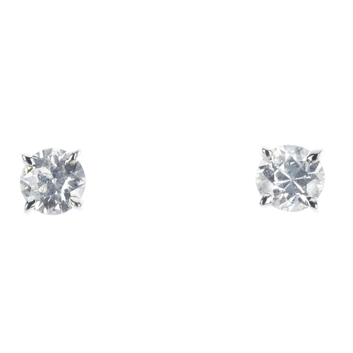 23 - A pair of 18ct gold old-cut diamond stud earrings. Estimated total diamond weight 0.90ct, H-I colour...