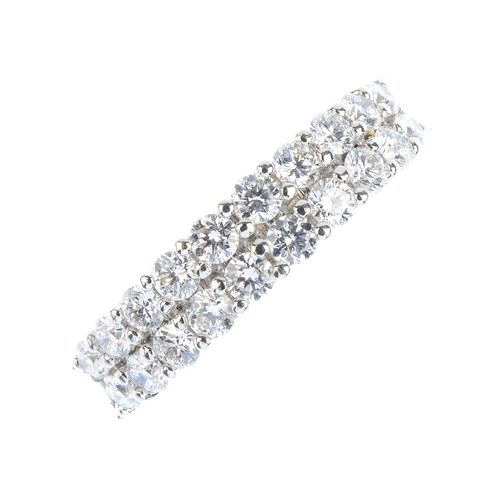 25 - An 18ct gold diamond half eternity ring. Comprising two brilliant-cut diamond lines, with tapered sh...