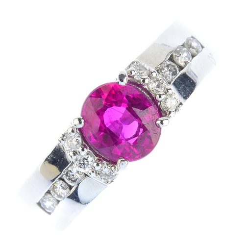 26 - A ruby and diamond ring. The oval-shape ruby, with brilliant-cut diamond line sides and shoulders. R...