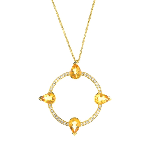 29 - An 18ct gold citrine and diamond pendant. The brilliant-cut diamond circle, intersected by four pear...