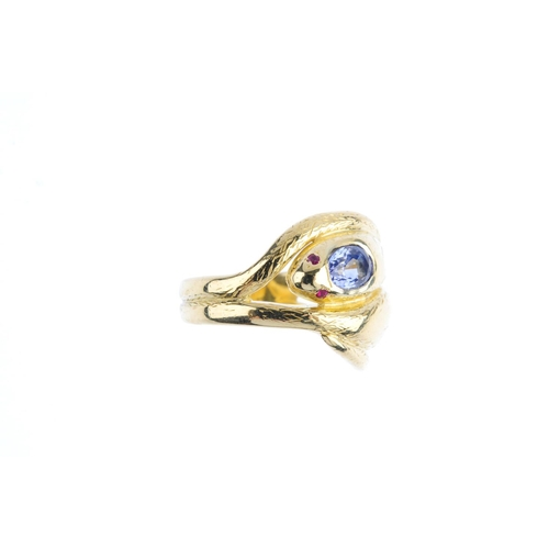 3 - A 1970s 18ct gold sapphire and ruby snake ring. Designed as two intertwined, textured snakes, each w...